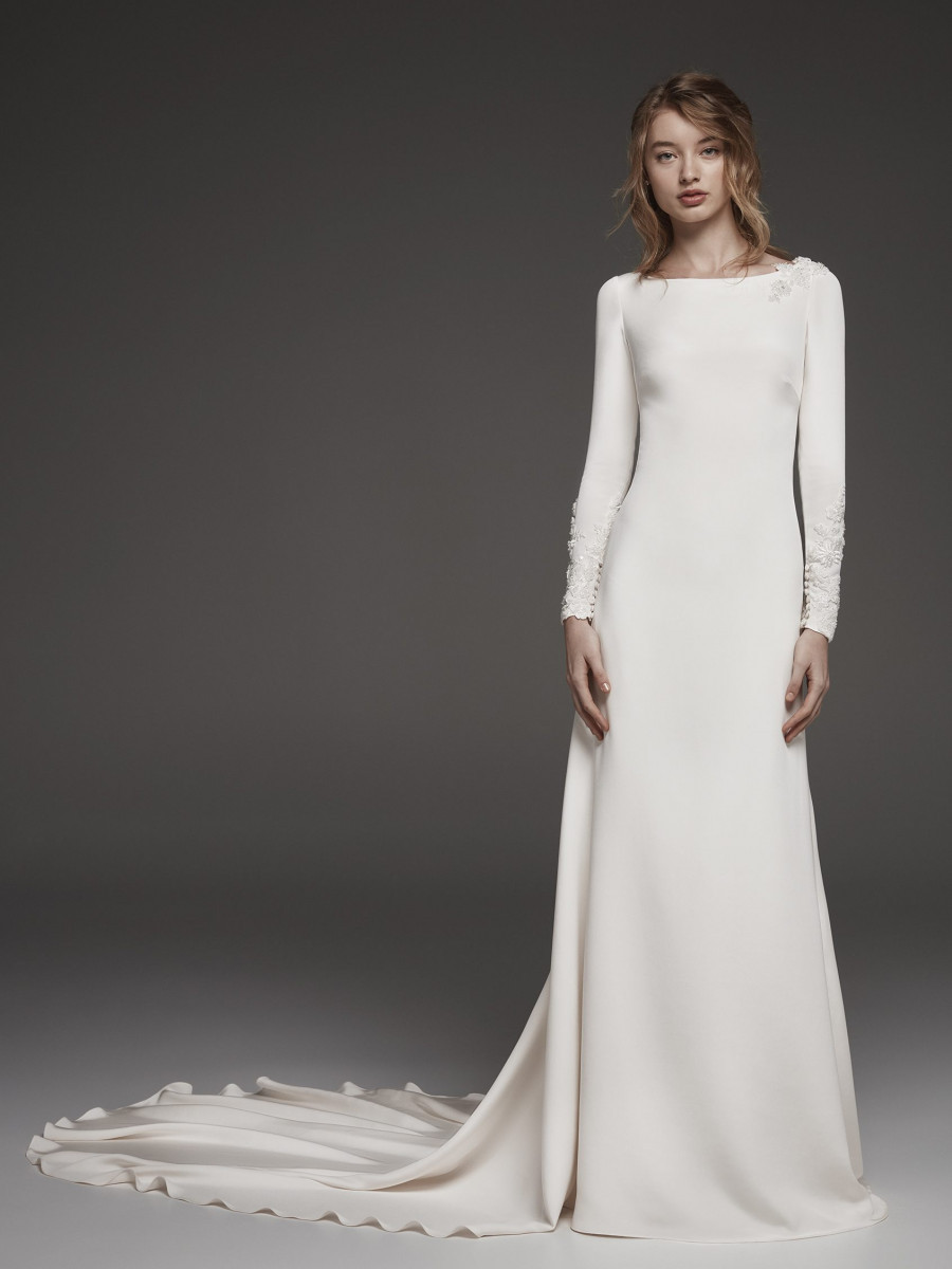 An Atelier Pronovias simple modest A-line wedding dress with long sleeves and a train