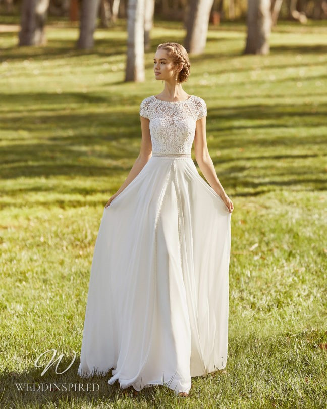 An Aire Barcelona 2021 flowy lace A-line wedding dress with cap sleeves