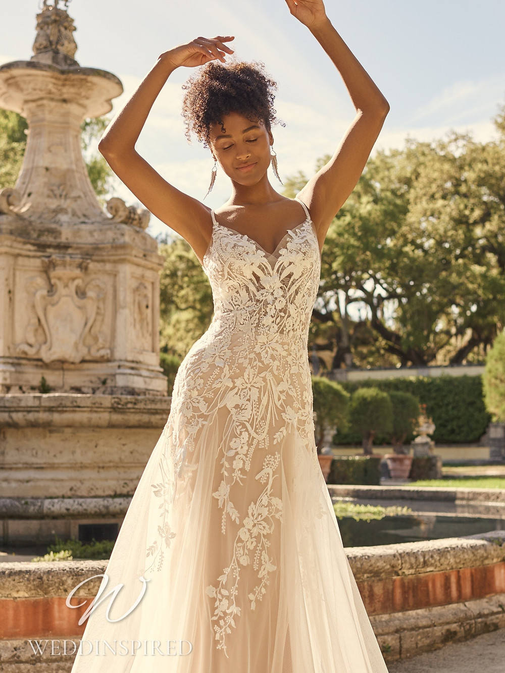 A Maggie Sottero 2021 blush lace and tulle A-line wedding dress
