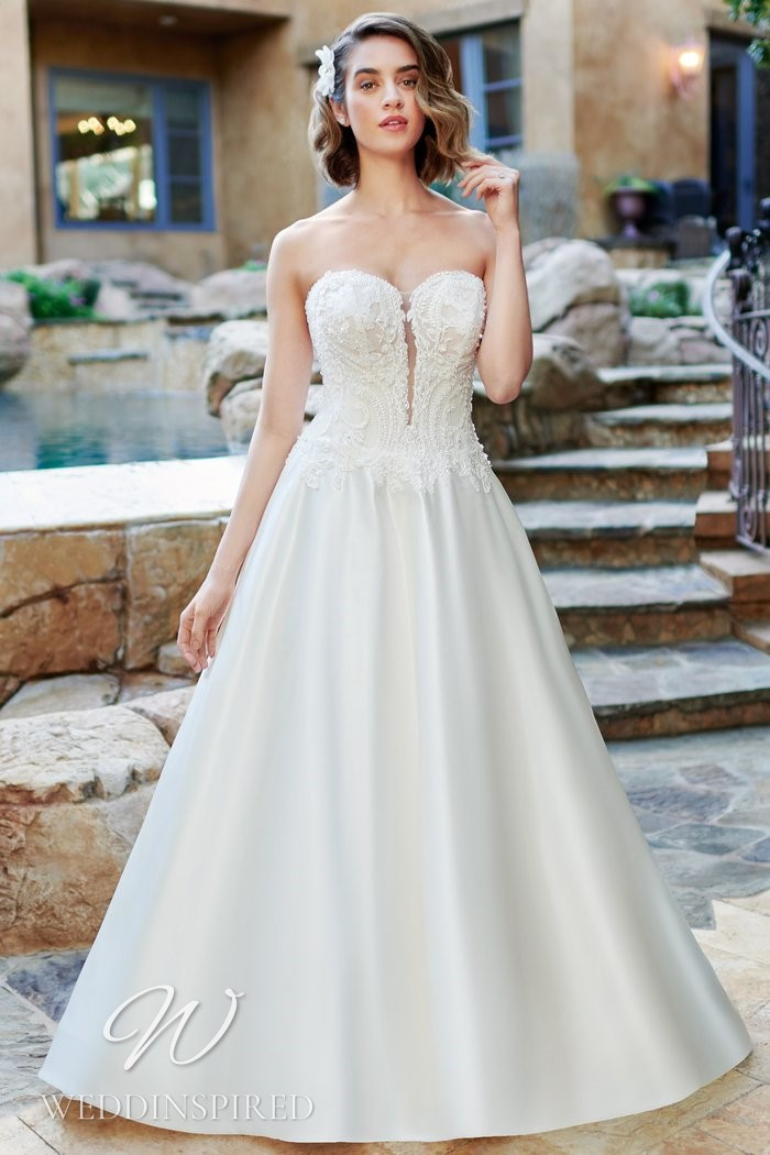 A Kenneth Winston 2021 strapless lace and satin A-line wedding dress