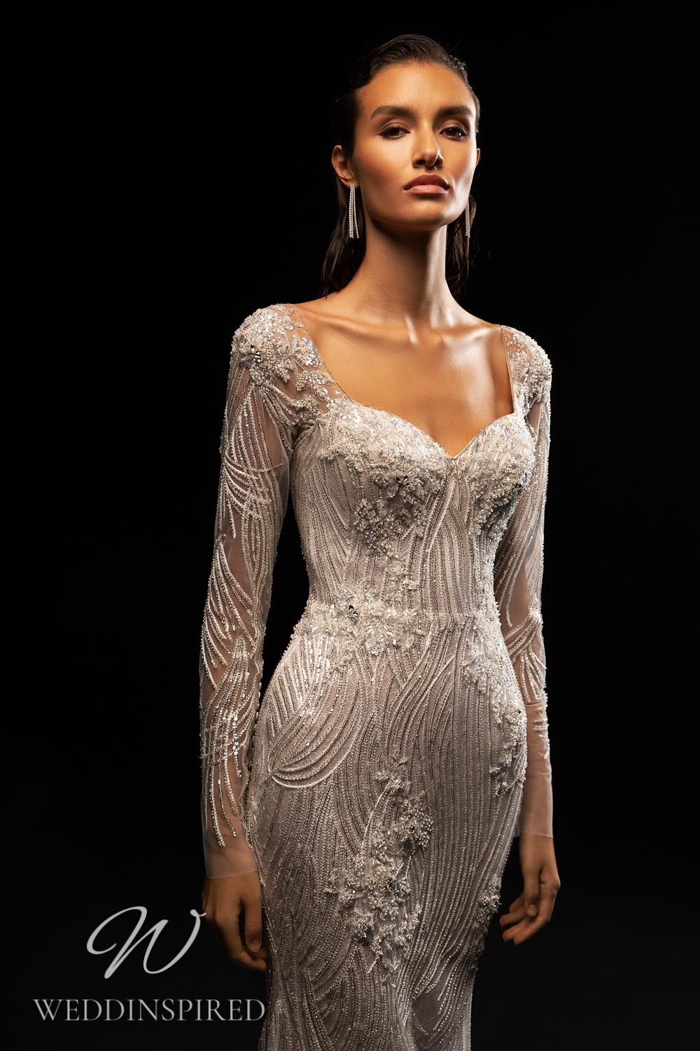 A WONÁ Concept 2021 silver mermaid wedding dress with long sleeves