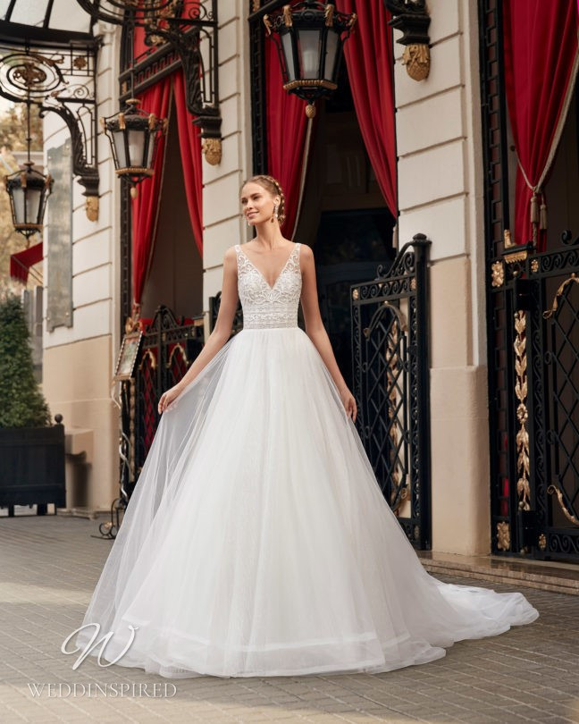 An Aire Barcelona 2021 lace and tulle princess wedding dress with a v neck