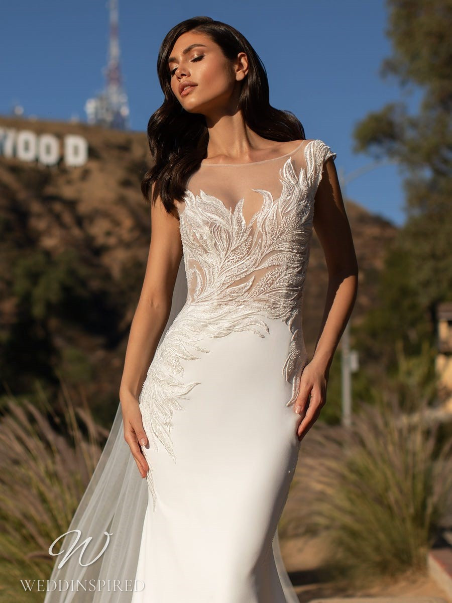 A Pronovias 2021 lace and crepe mermaid wedding dress with an illusion neckline