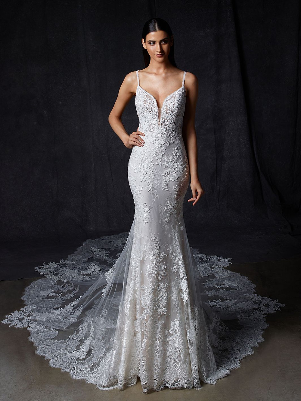 An Enzoani lace mermaid wedding dress, with thin straps and a long train