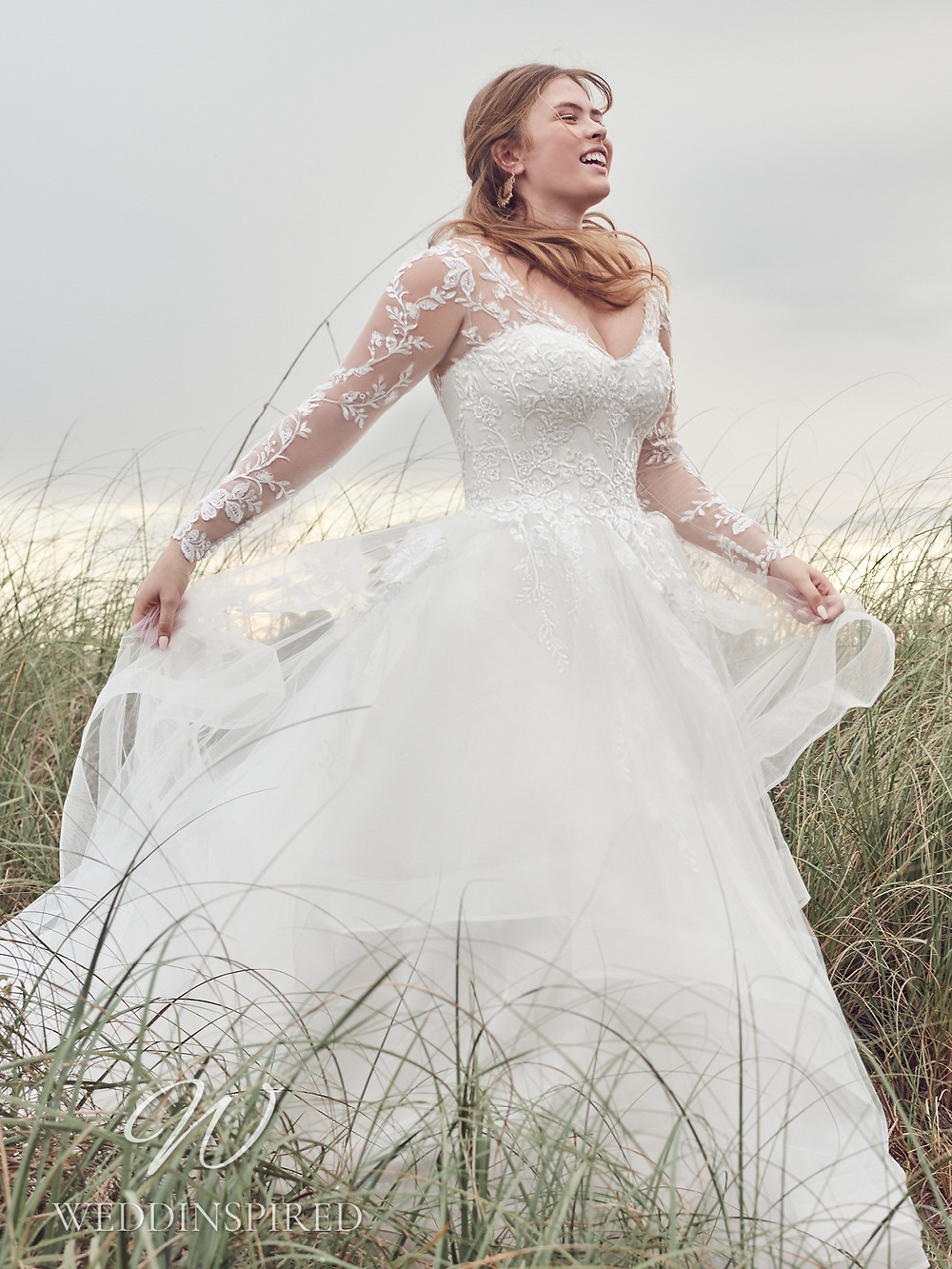 A Rebecca Ingram 2021 plus size lace and tulle A-line wedding dress with long sleeves