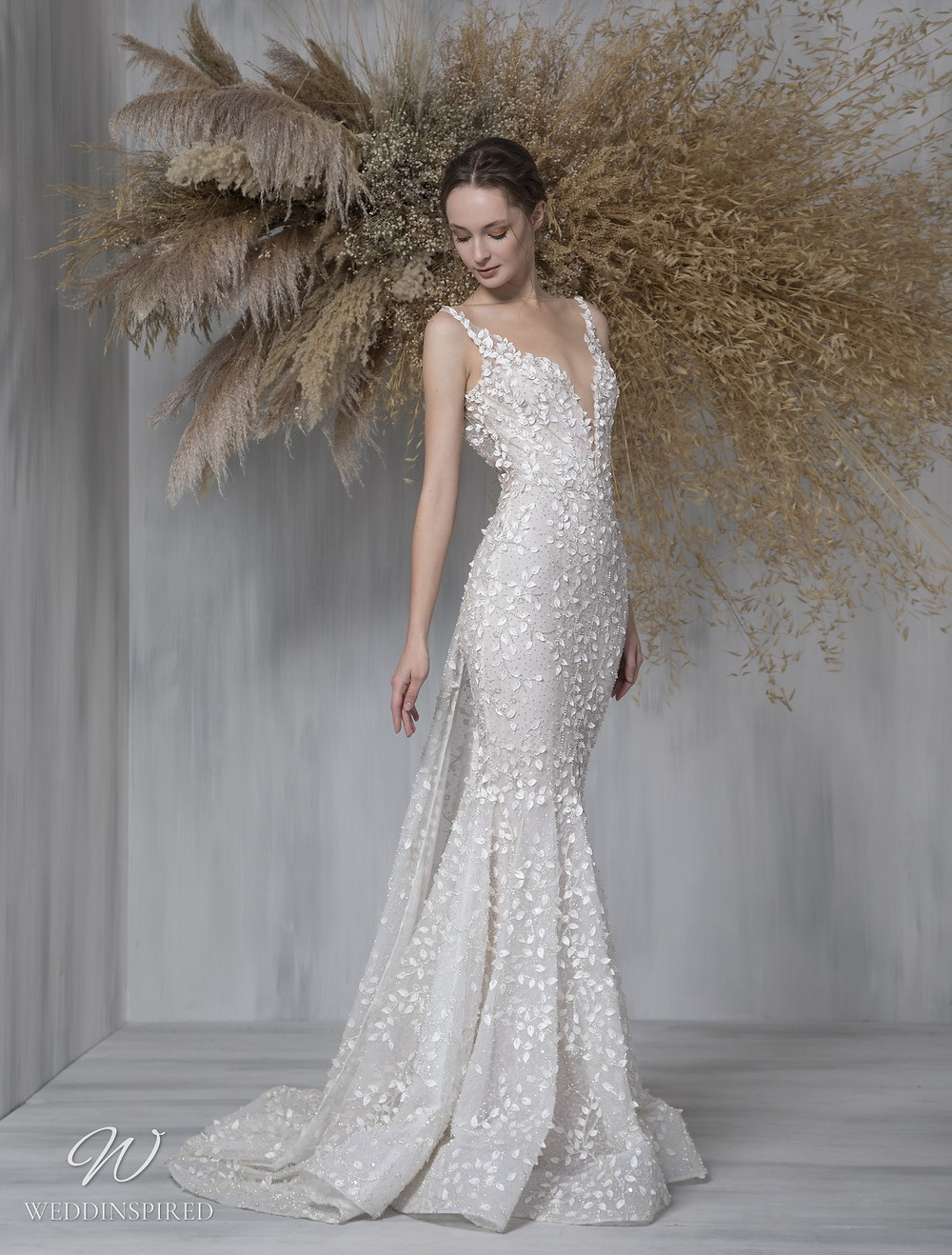 A Tony Ward 2021 lace mermaid wedding dress with a v neck and straps