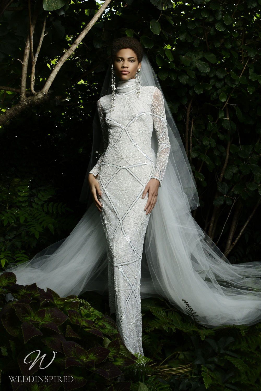A Naeem Khan Fall 2021 modest sparkly mermaid wedding dress with long sleeves and a high neckline