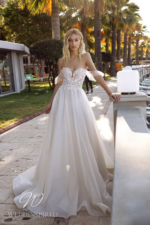 A Tina Valerdi lace off the shoulder A-line wedding dress
