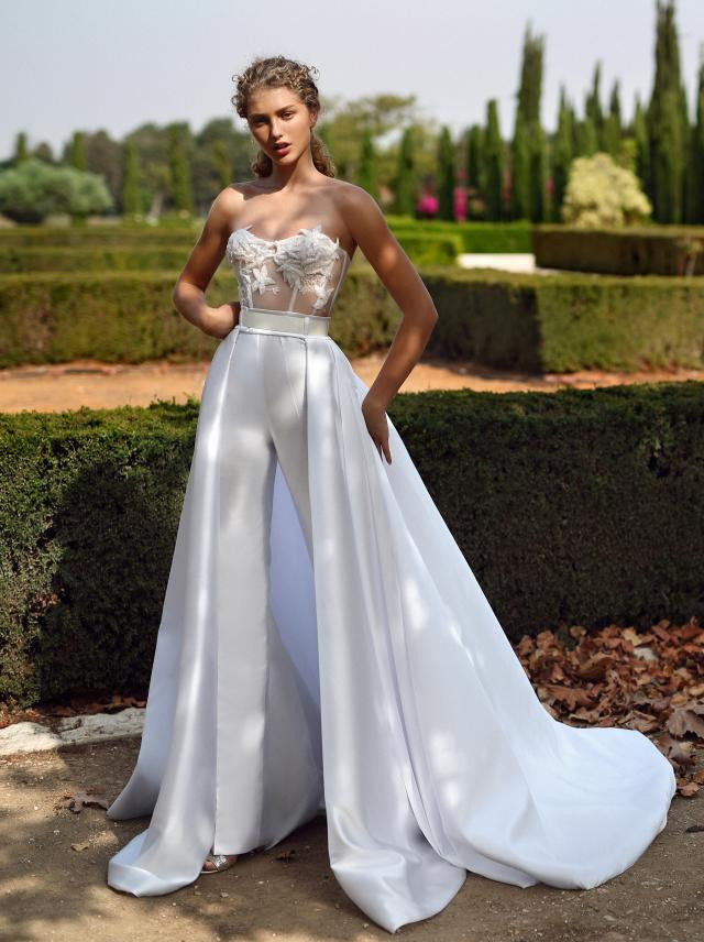 A Galia Lahav strapless lace wedding jumpsuit or pantsuit with a detachable skirt