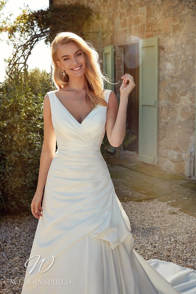 An Eddy K 2021 simple satin A-line wedding dress with a v neck