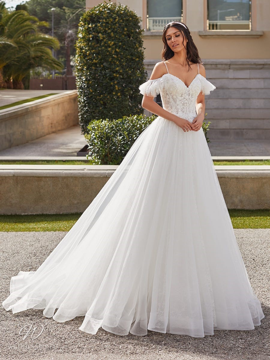 A Pronovias 2021 lace and mesh off the shoulder ball gown wedding dress