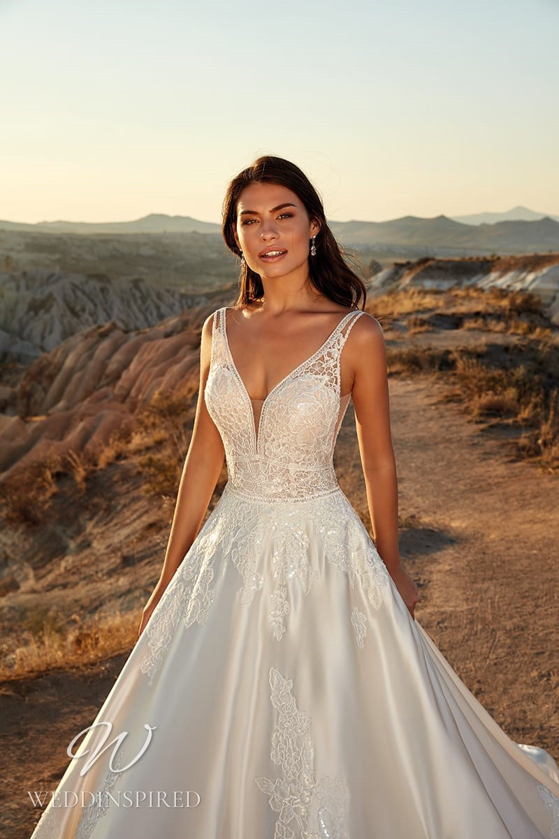 An Eddy K 2021 lace and satin A-line wedding dress with straps