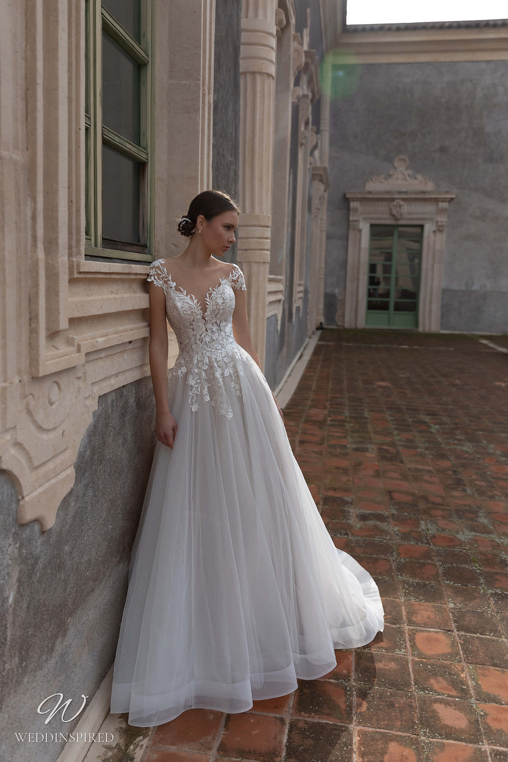 A Naviblue lace and tulle off the shoulder A-line wedding dress