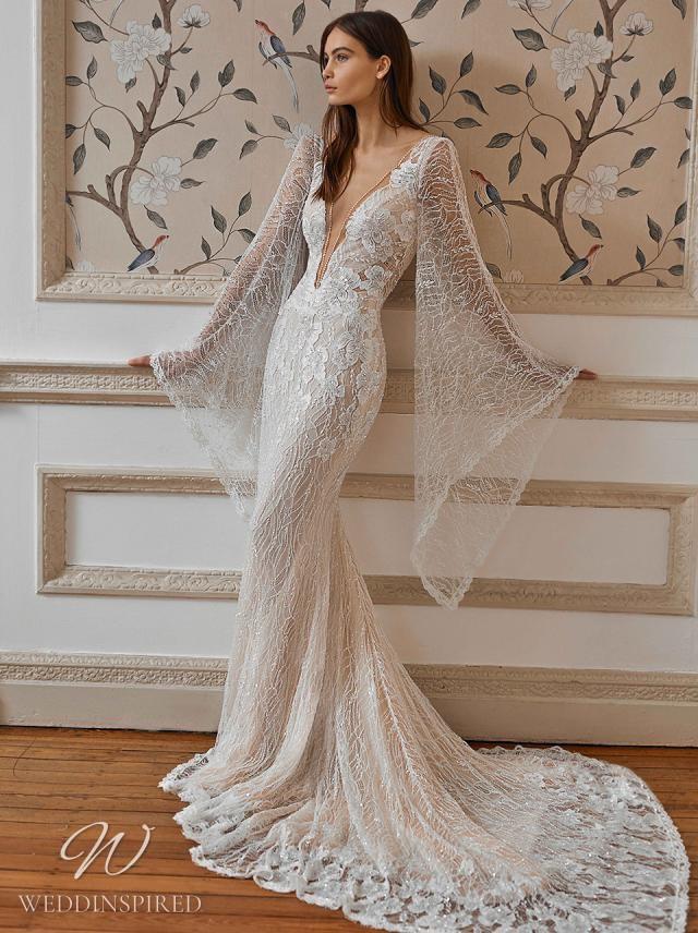 A Galia Lahav 2021 lace v neck mermaid wedding dress with long draping sleeves and a train