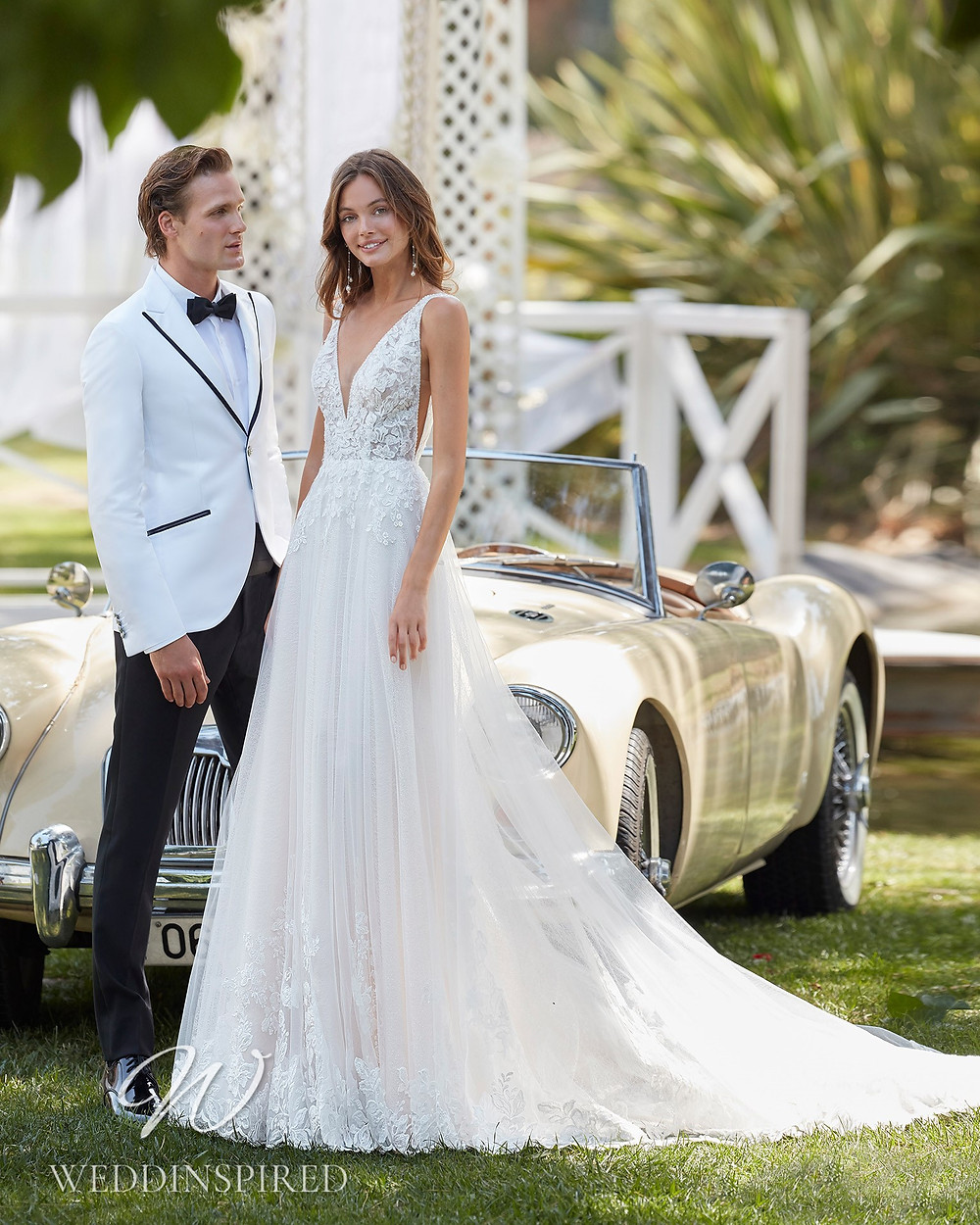 An Aire Barcelona 2021 lace and tulle A-line wedding dress with a v neck