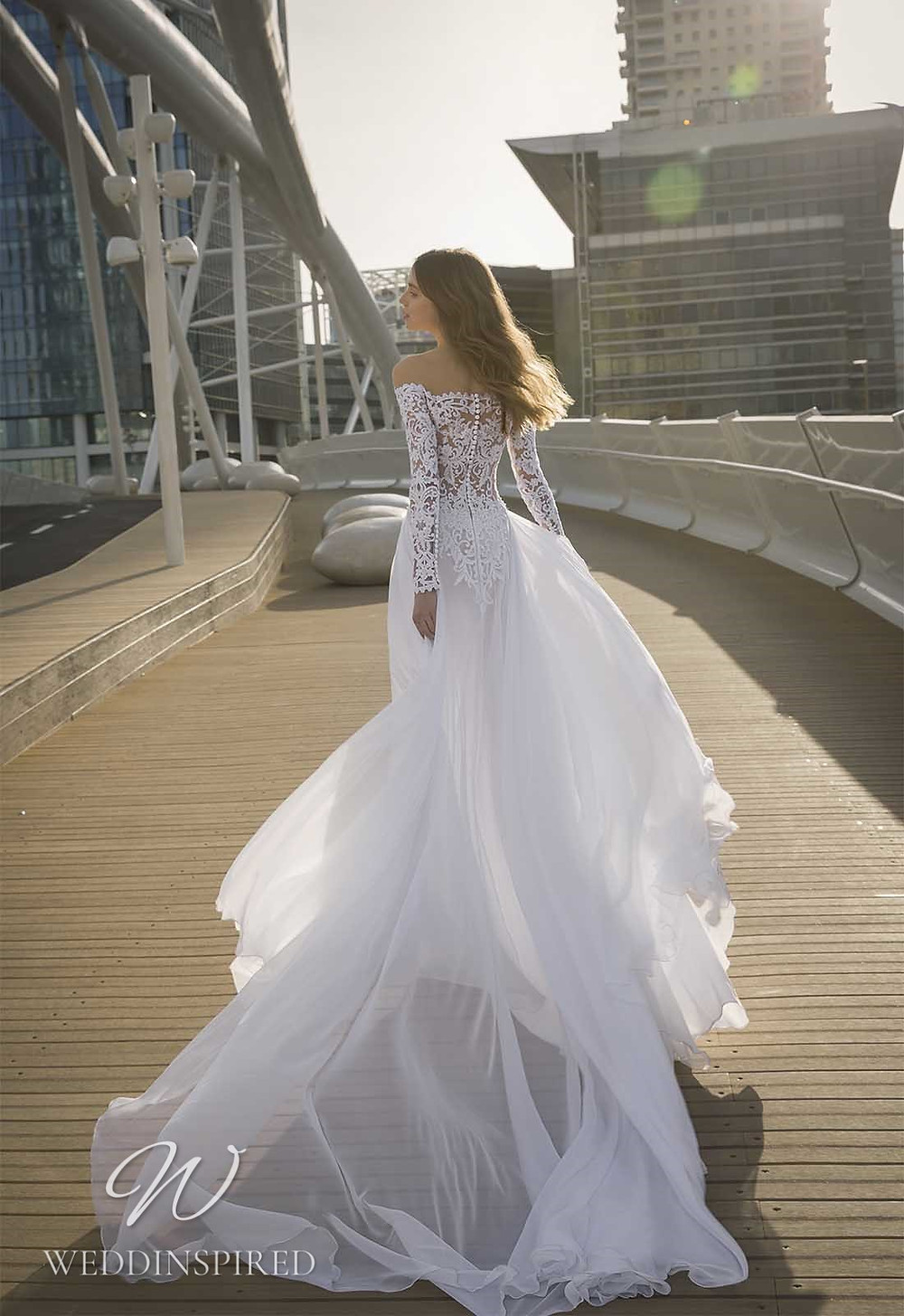 A Pnina Tornai 2021 off the shoulder lace A-line wedding dress with long sleeves