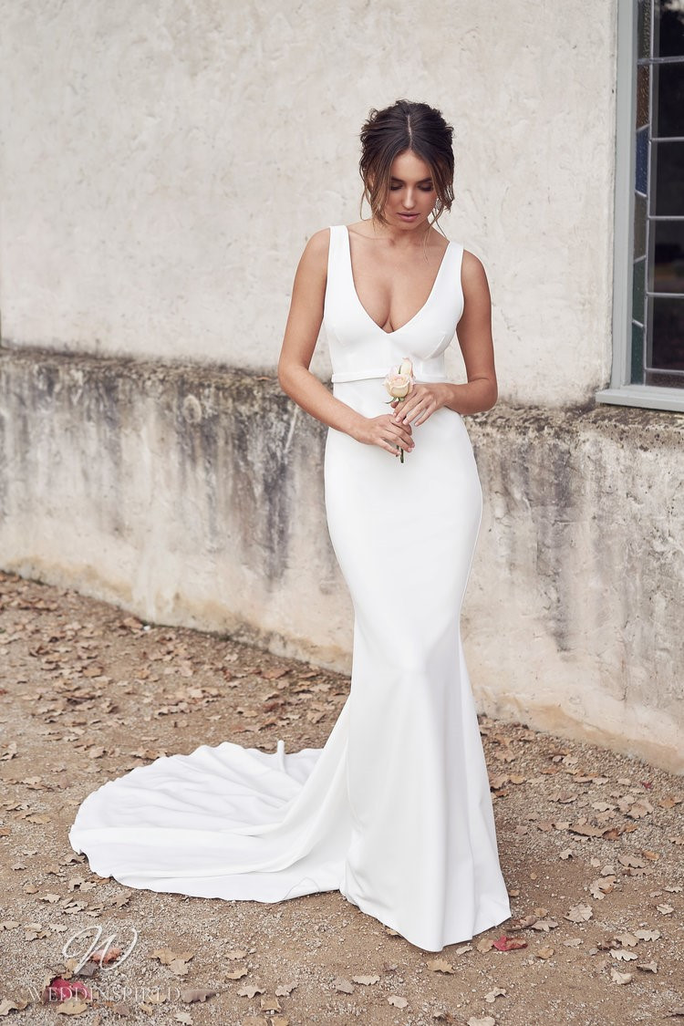 An Anna Campbell 2020 low v neck sheath wedding dress with a long train