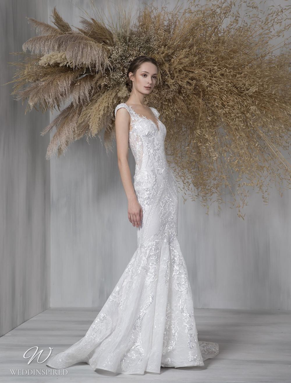 A Tony Ward 2021 lace mermaid wedding dress with cap sleeves
