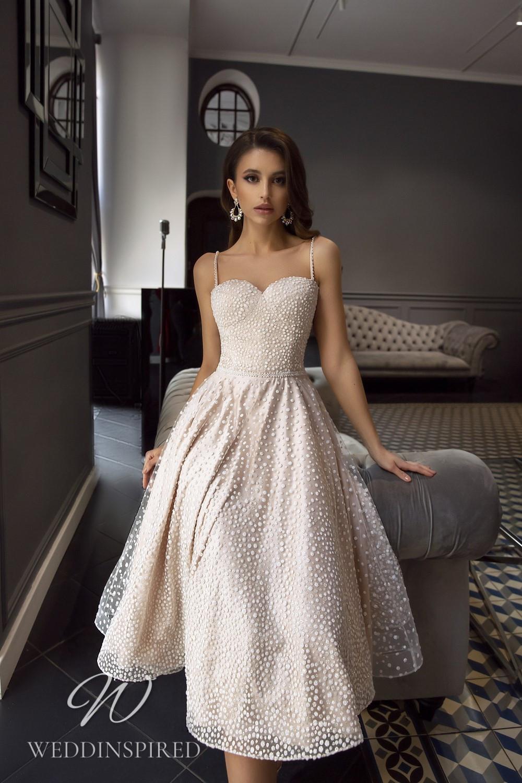 A Tina Valerdi blush tea length wedding dress