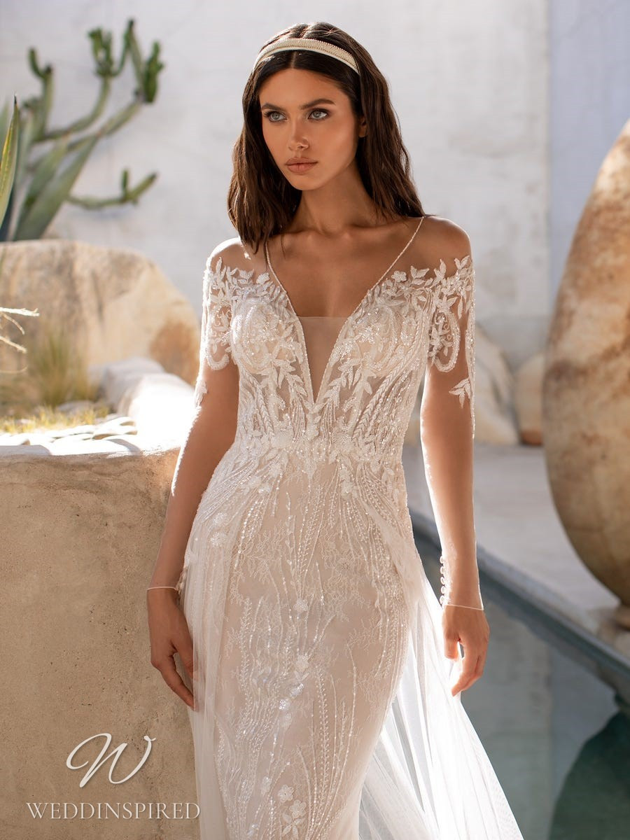 A Pronovias 2021 blush sparkly lace mermaid wedding dress with long sleeves