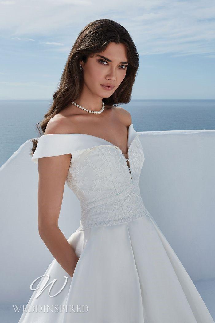 A Justin Alexander 2021 satin off the shoulder A-line wedding dress
