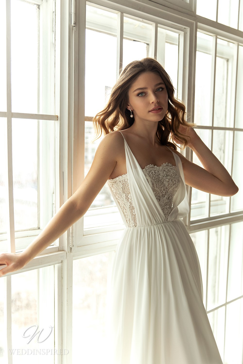 An Eva Lendel 2021 lace and crepe A-line wedding dress
