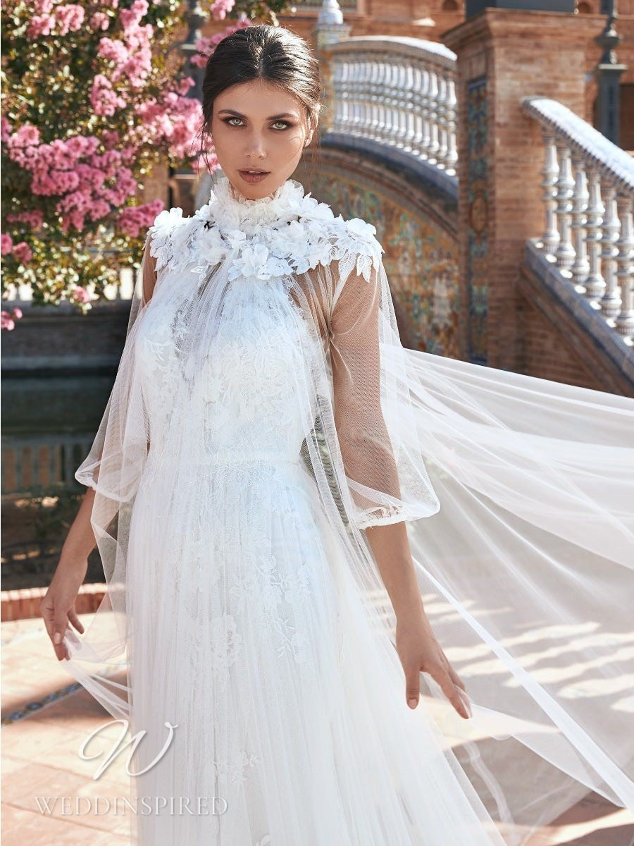A Marchesa for Pronovias 2022 tulle and lace halterneck wedding dress with a cape