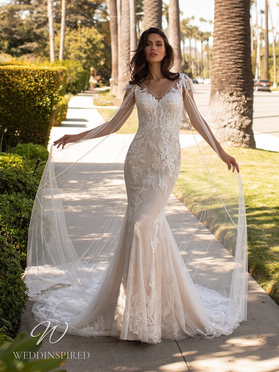 An Ashley Graham x Pronovias 2021 blush lace mermaid wedding dress with straps and a v neck