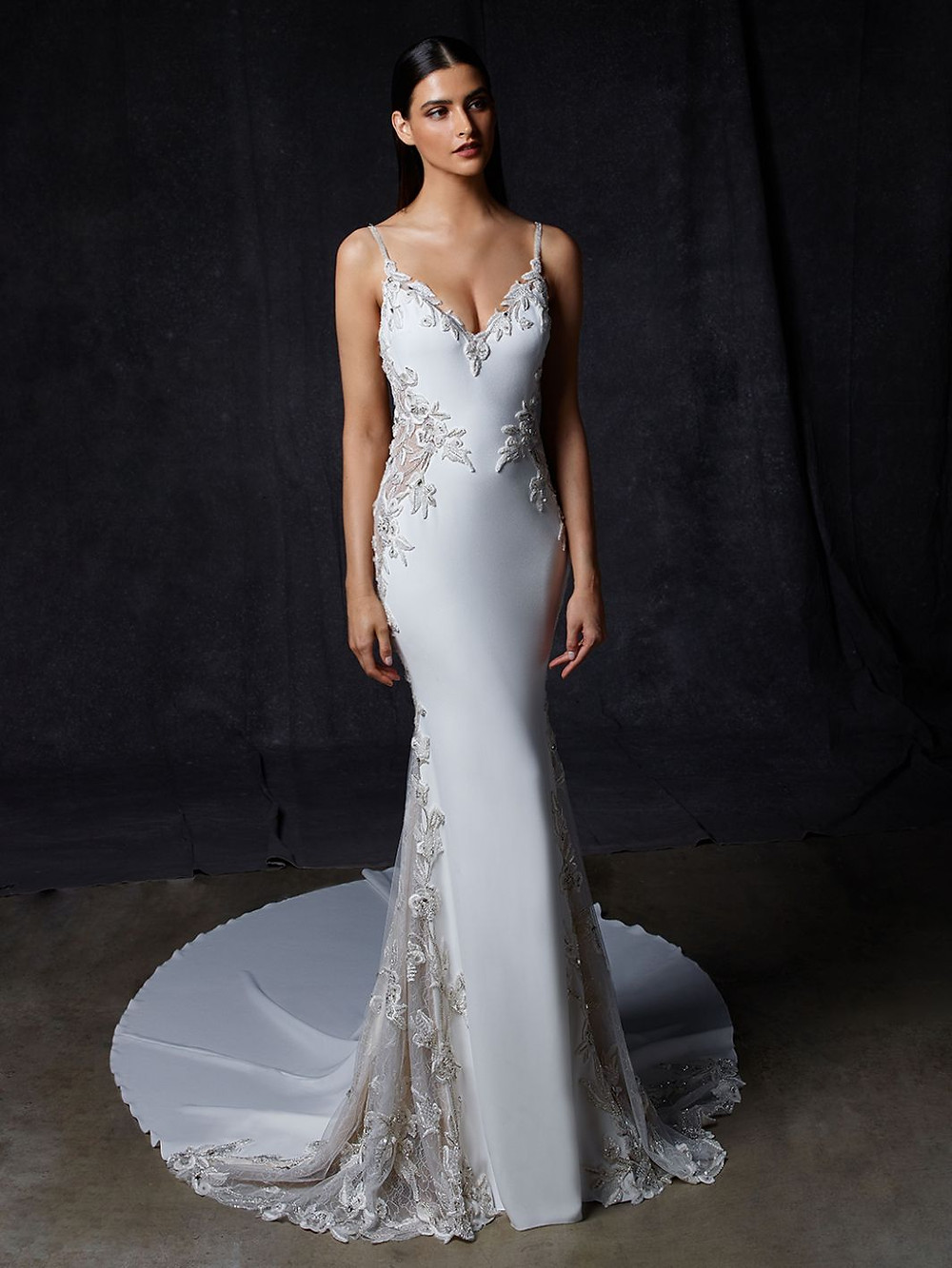 An Enzoani silk mermaid wedding dress with lace, thin straps and a long train