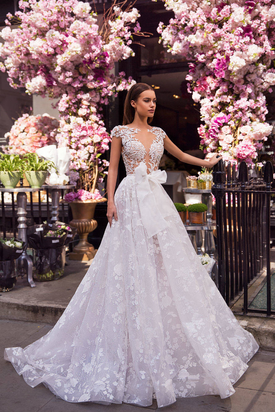 A Milla Nova lace and tulle princess ball gown wedding dress with a bow