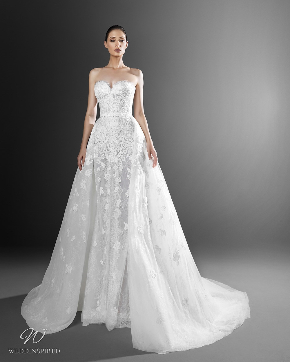 A Zuhair Murad mermaid off the shoulder wedding dress with a sweetheart neckline, lace and a detachable skirt