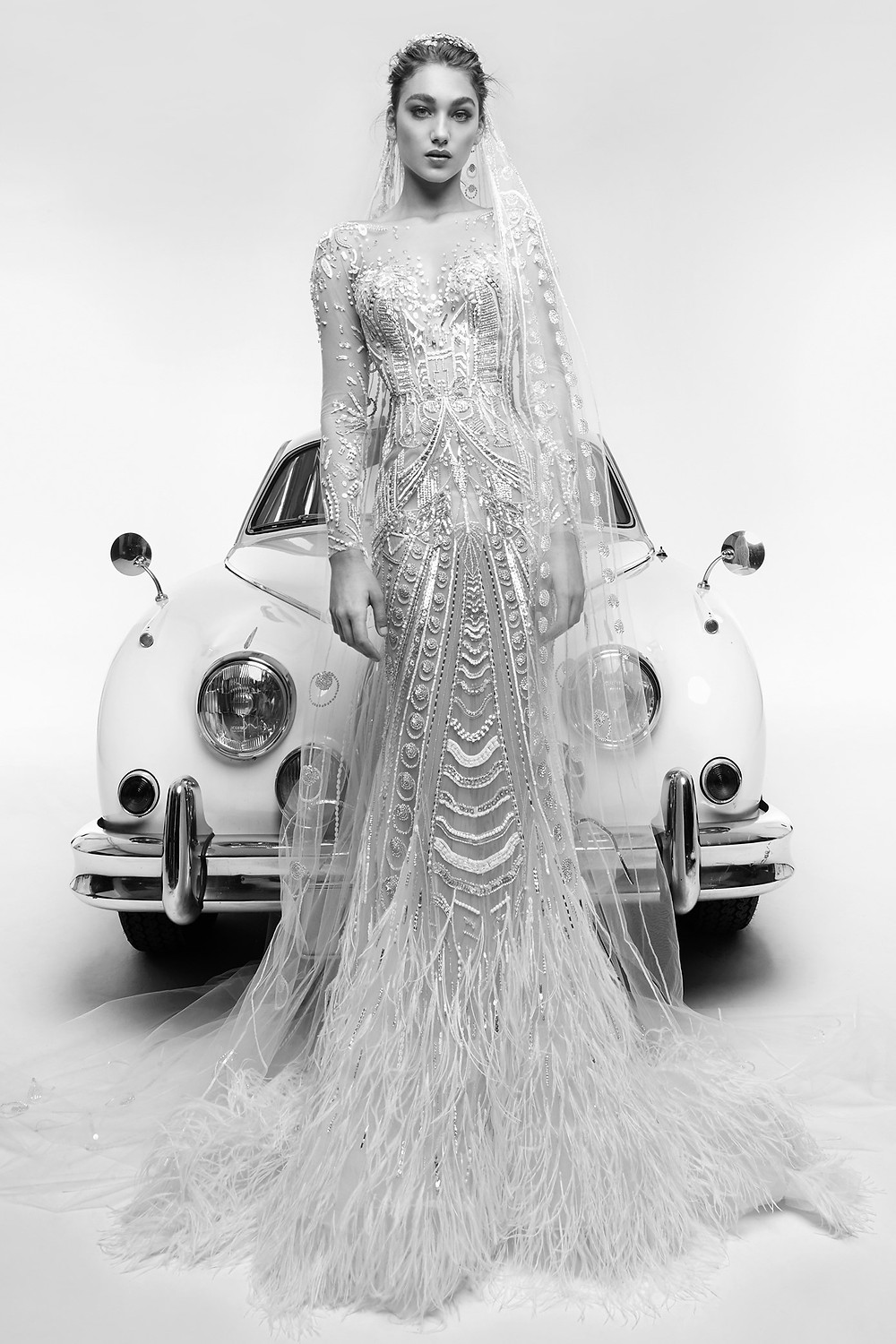 A Zuhair Murad mesh, beading and feathers mermaid wedding dress with long sleeves