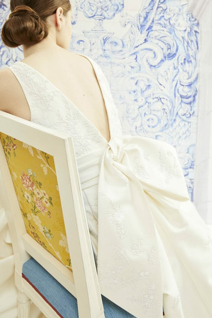 A Carolina Herrera fitted ivory crepe wedding dress with a big bow