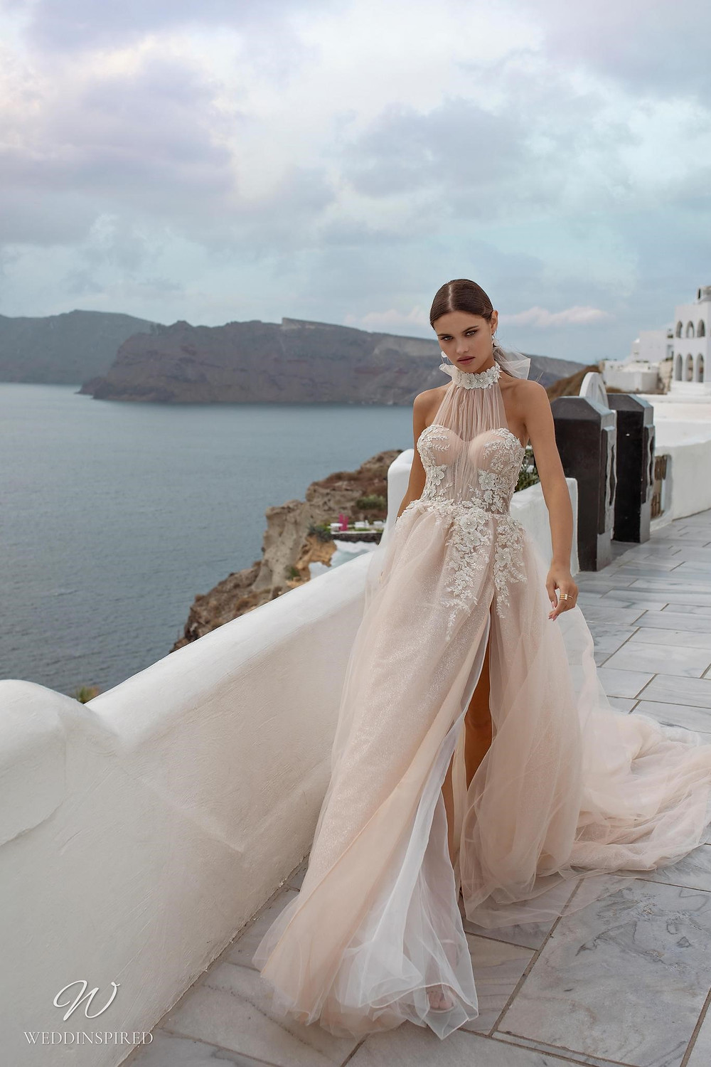 A Ricca Sposa halterneck blush tulle romantic ball gown wedding dress with a sweetheart neckline