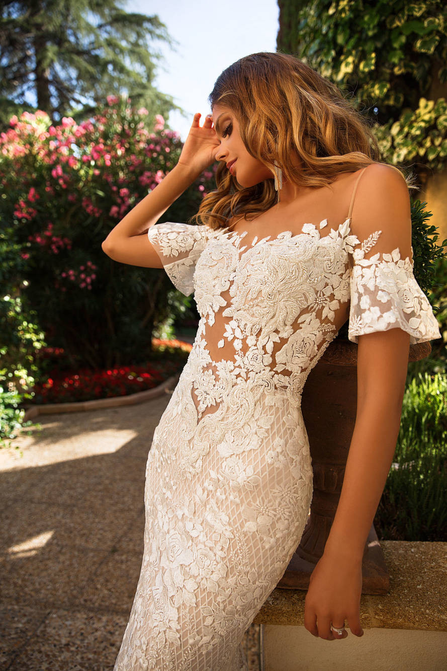 A Milla Nova sexy off the shoulder lace mermaid fit and flare wedding dress