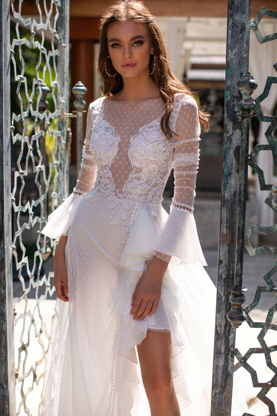 A Milla Nova tulle, 3/4 bell sleeve, A-line wedding dress, with lace