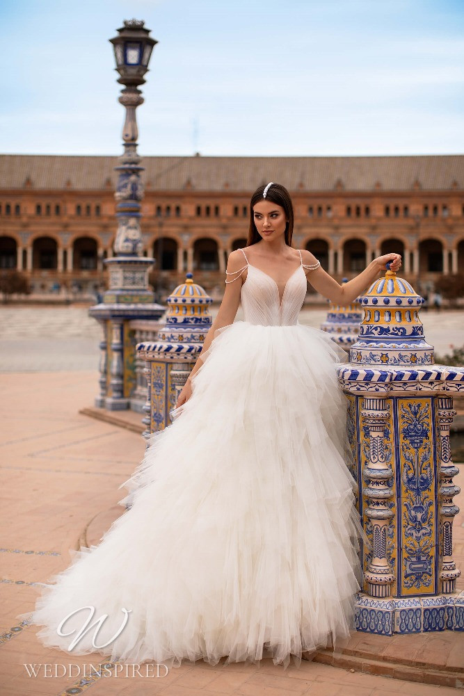 A Nora Naviano 2021 tulle princess wedding dress with a ruffle skirt
