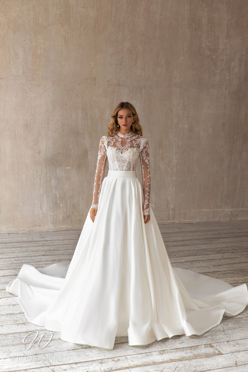 An Eva Lendel 2021 lace mermaid wedding dress with a silk detachable skirt and long illusion sleeves