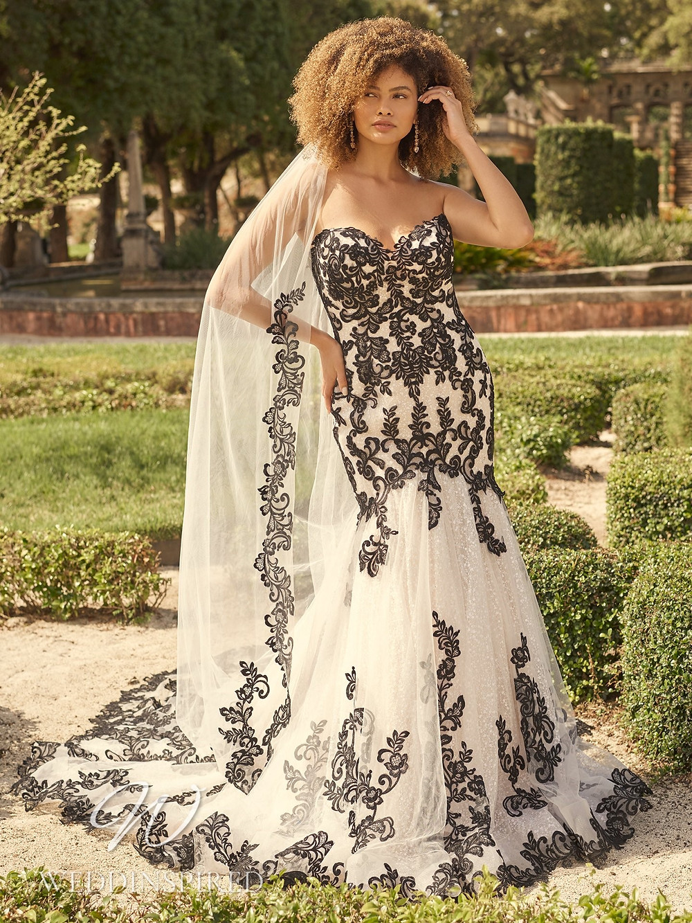 A Maggie Sottero 2021 black and white lace strapless mermaid wedding dress