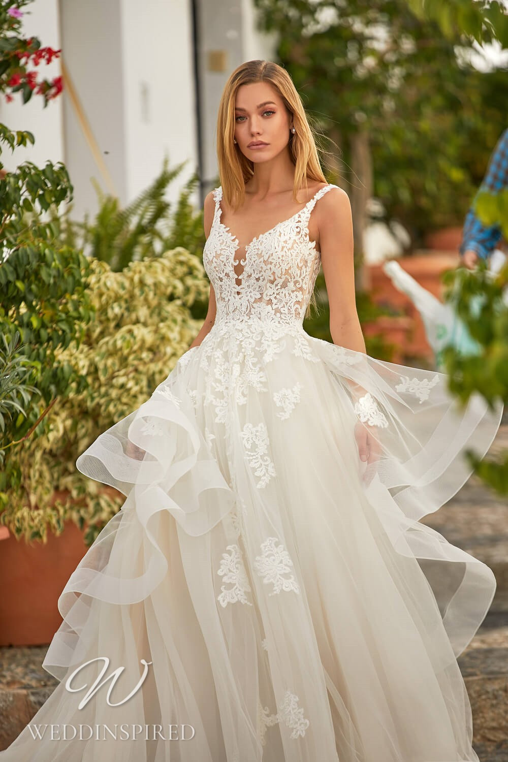 An Essential by Lussano 2021 lace and tulle princess wedding dress with a ruffle skirt