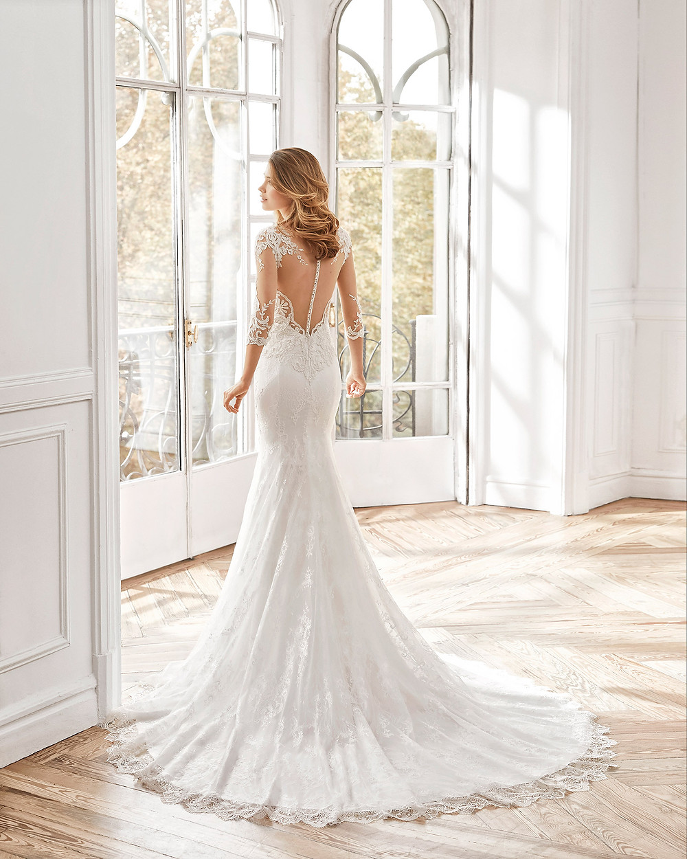 An Aire Barcelona 2020 lace mermaid fit and flare wedding dress with an illusion back and long sleeves