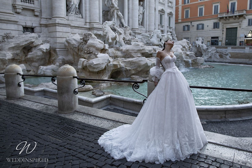 A Pinella Passaro lace princess ball gown wedding dress with a sweetheart neckline