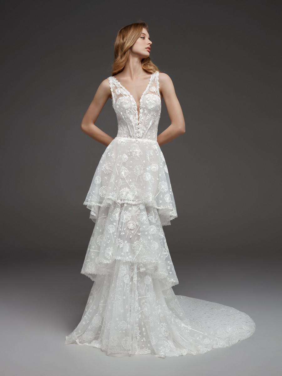 A Pronovias A-line wedding dress with a layered lace skirt, straps and a deep v neckline