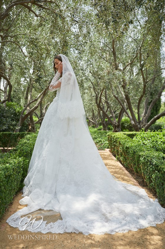 A Monique Lhuillier lace ball gown wedding dress with long illusion sleeves
