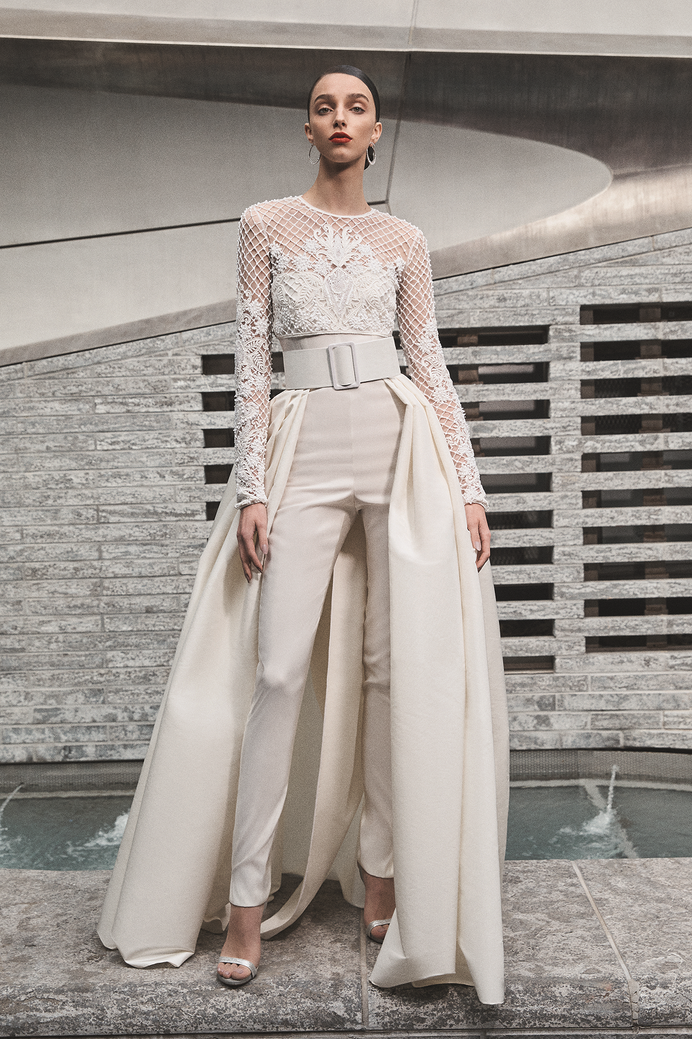 A Naeem Khan linen wedding jumpsuit or pantsuit with lace and a detachable skirt