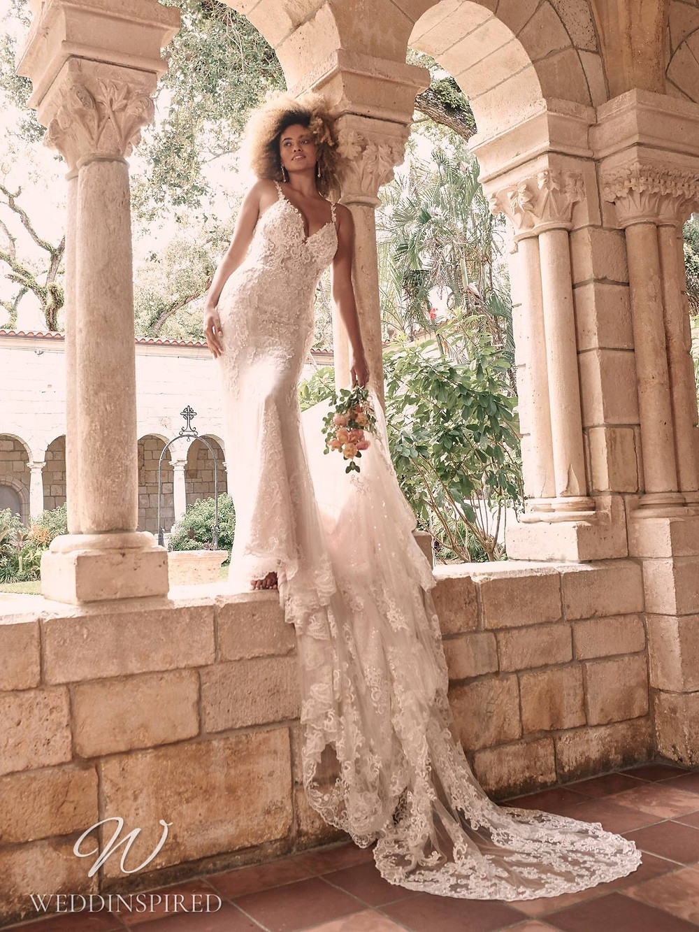 A Maggie Sottero Spring 2021 lace mermaid wedding dress with a v neck and a train