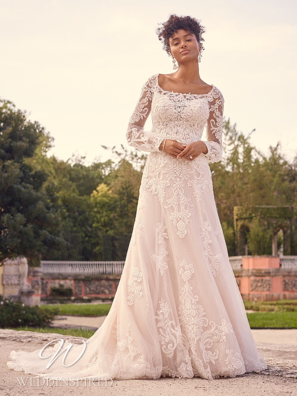 A Maggie Sottero 2021 lace A-line wedding dress with long sleeves