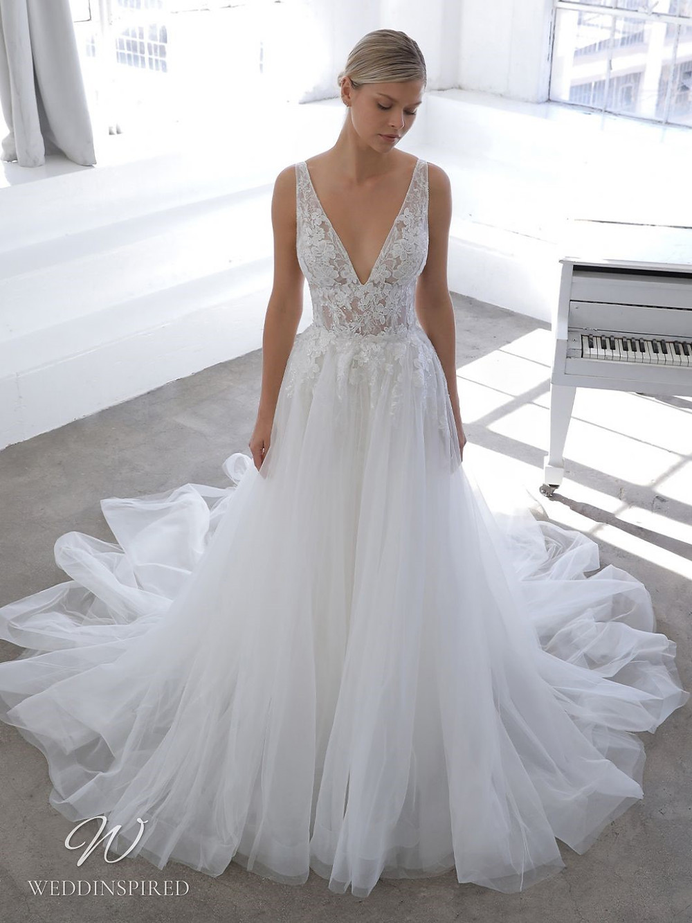 A Blue by Enzoani 2021 lace and tulle A-line wedding dress with straps and a v neck