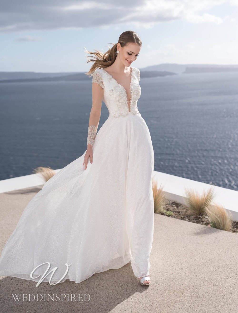 A Blunny 2021 flowy lace and tulle A-line wedding dress with a v neck