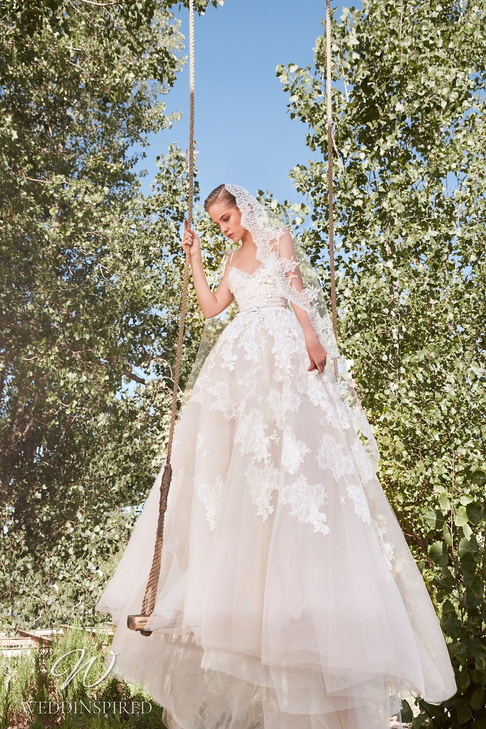 An Elie Saab Spring 2021 blush lace romantic ball gown wedding dress with straps and a v neck